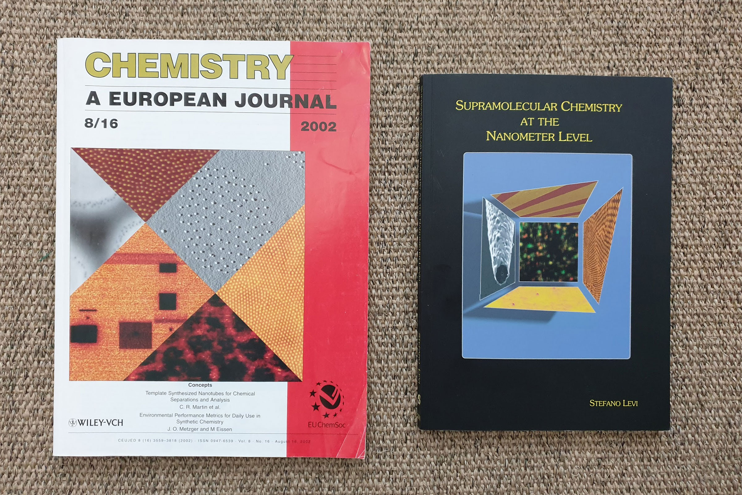 The images of my research on the cover of Chemistry, a European Journal, and a copy of my Ph.D. Thesis